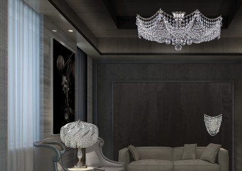 Table lamps and crystal chandelier in bedroom